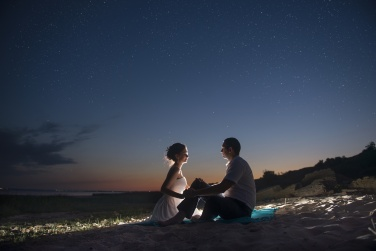 The couple on the seashore at night